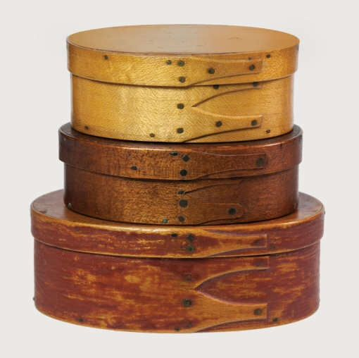 """Lot 58: Three Oval Boxes Estimate: $1,000 – $2,000. Realized: $1,550 hammer. Pine and maple, smallest box with original yellow stained varnish finish, three fingers, 1 5/16"""" h, 3 1/2"""" l; middle box in original light walnut stained finish, three fingers, (one tack missing), 1 3/8"""" h, 3 3/4"""" l; largest in original brick red stain/painted finish, three fingers, 1 5/8"""" h, 4 1/2"""" l, (Flo and Howard Fertig collection). SKU: 20142058. Willis Henry Category: Shaker Auction - Sept. 6th, 2014."""