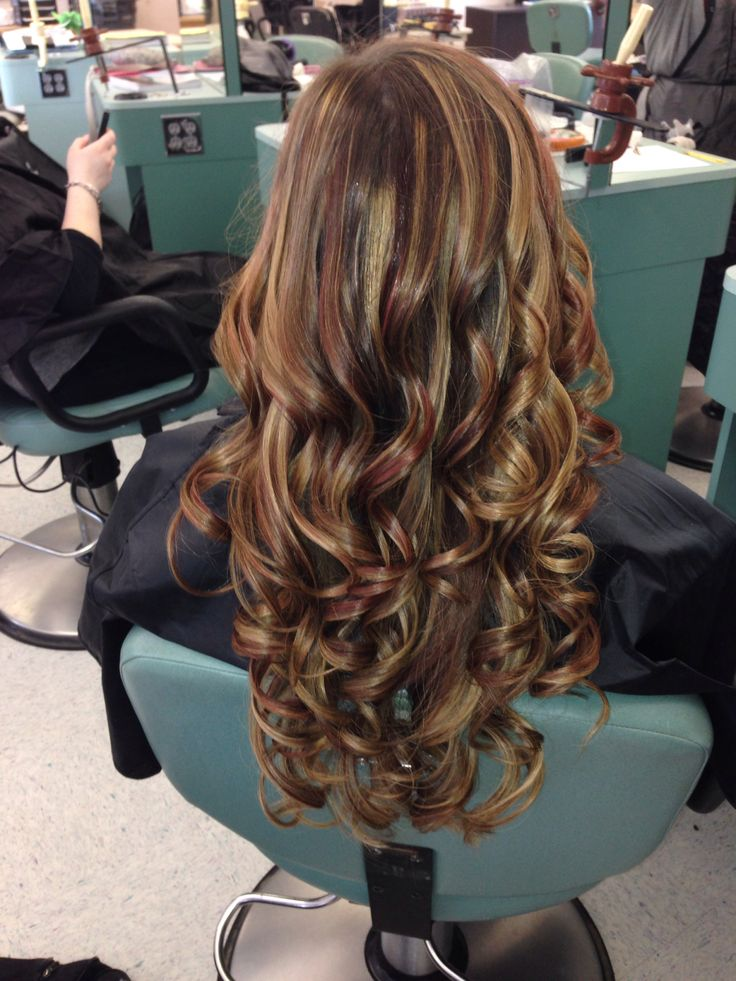 Curled hair with blonde and red highlights and brown low ...