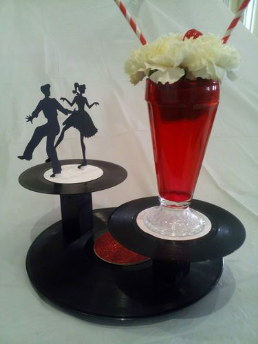 Super Cool Daddio 50s Sock Centerpieces www.tablescapesbydesign.com https://www.facebook.com/pages/Tablescapes-By-Design/129811416695