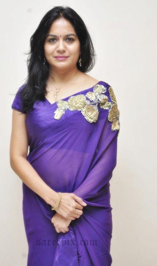 "Telugu singer Sunitha in purple designer saree at ""Naa bangaru thalli"" premiere show. Beauty was eye catchy in purple transparent plain saree."