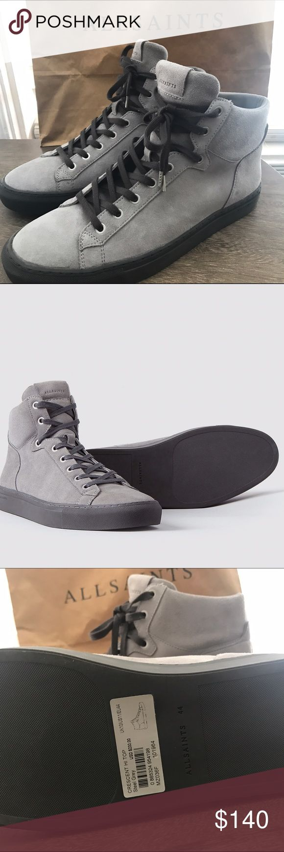 All Saints Crescent  Hi Top NWT. Purchased as a gift for my husband, and he kept them but they are a little too big for him as a 10.5 so never worn. They are leather trainers with a gray suede exterior. Size 44 (11 for men) We don't have the box anymore, but I still have the shopping bag and will ship with that. Great all year round.  Model: CRESCENT HI TOP  Model Number: MZ001F  Numerous trimmings and detailing throughout the trainers including All Saints embossed on the exterior tongue…