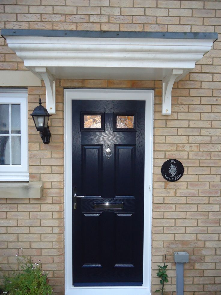 Navy blue composite front door installed by cove windows for Navy blue front door