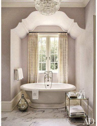 A sparkling chandelier is a grace note in the master bath of an Atlanta home devised by decorator Suzanne Kasler and architectural designer William T. Baker | archdigest.com