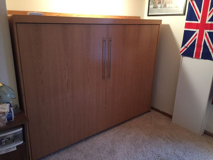 """Our customer from Madelia, Minnesota chose the Bedder Way Horizontal Full Shaker Face Murphy bed in oak stained Golden Oak with 21"""" brushed chrome contemporary handles."""
