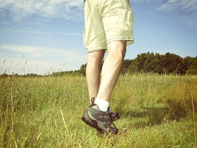 Check out Man in shorts hiking in grass by Patricia Hofmeester on Creative Market