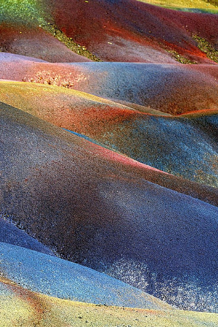 20 UNREAL Travel Destinations!  The multicolored earth in Chamarel was formed when volcanic rock cooled at different temperatures. For those of you who don't know where Chamarel is, it is a city in the country of Mauritius.  For those of you who don't know where Maritius is, it is a country in the Indian Ocean off the coast of Africa.