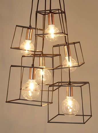 BHS // Illuminate Atelier // Paola 6 Light Cluster // Industial glam black cage box cluster with exposed bulbs and copper detailing