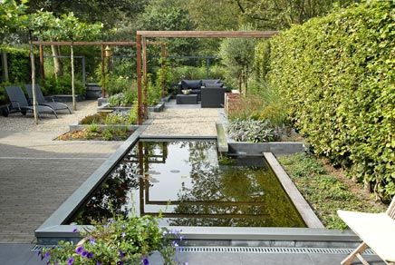Elongated garden with tight pond | Inrichting-huis.com