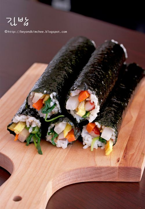 Kimbap, a sort of Korean sushi roll (without raw fish); you can also make this with beef instead of crab and fish cakes.