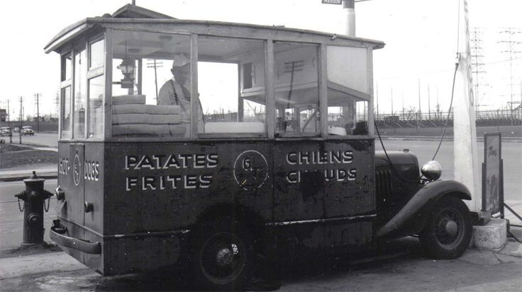 This historic photo shows an old time Montreal food cart, which have now been long banned from the city.