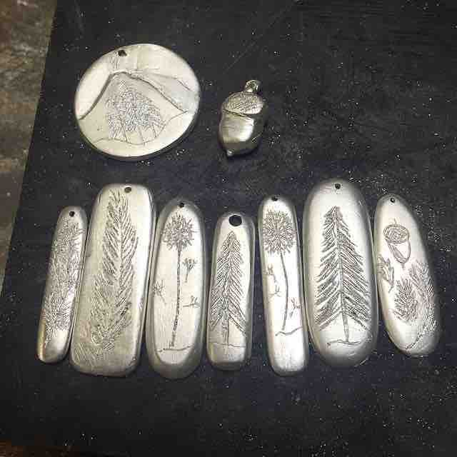 Raw silver just in from the casting house. I can't wait to get these hand-carved pendants finished,  polished and ready for the @handmadesamford markets on Saturday! Also Available soon in the Etsy Store http://etsy.me/28QBOJ1 . . . . #blackdogdesignsau #RuggedAF #pendants #sterlingsilver #rawsilver #handmadesamford #nature #mountains #mountain #trees #wander #wanderer #jewellery #etsy #etsyshop #etsyau #pendant #accessories