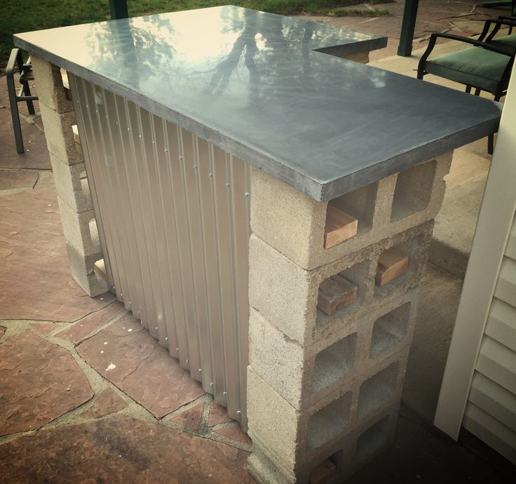 Truly Rustic outdoor bar Custom Grey Concrete Countertop with cinder blocks for support some