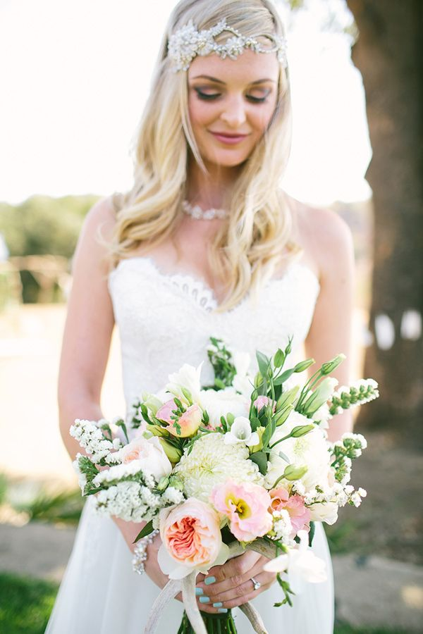 spring wedding bouquet - photo by Vis Photography http://ruffledblog.com/handcrafted-boho-woodsy-wedding #flowers #weddingbouquet #bouquets