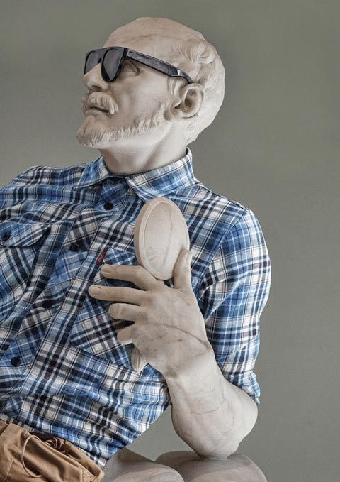 """After spending a day at the Louvre in Paris, photographer Leo Caillard had the genius idea to dress classic statues in what he calls """"hipster"""" clothing. These nude statues represent an ideal iconic figure, a concept of perfection. By clothing them, Caillard is addressing the power of representation."""