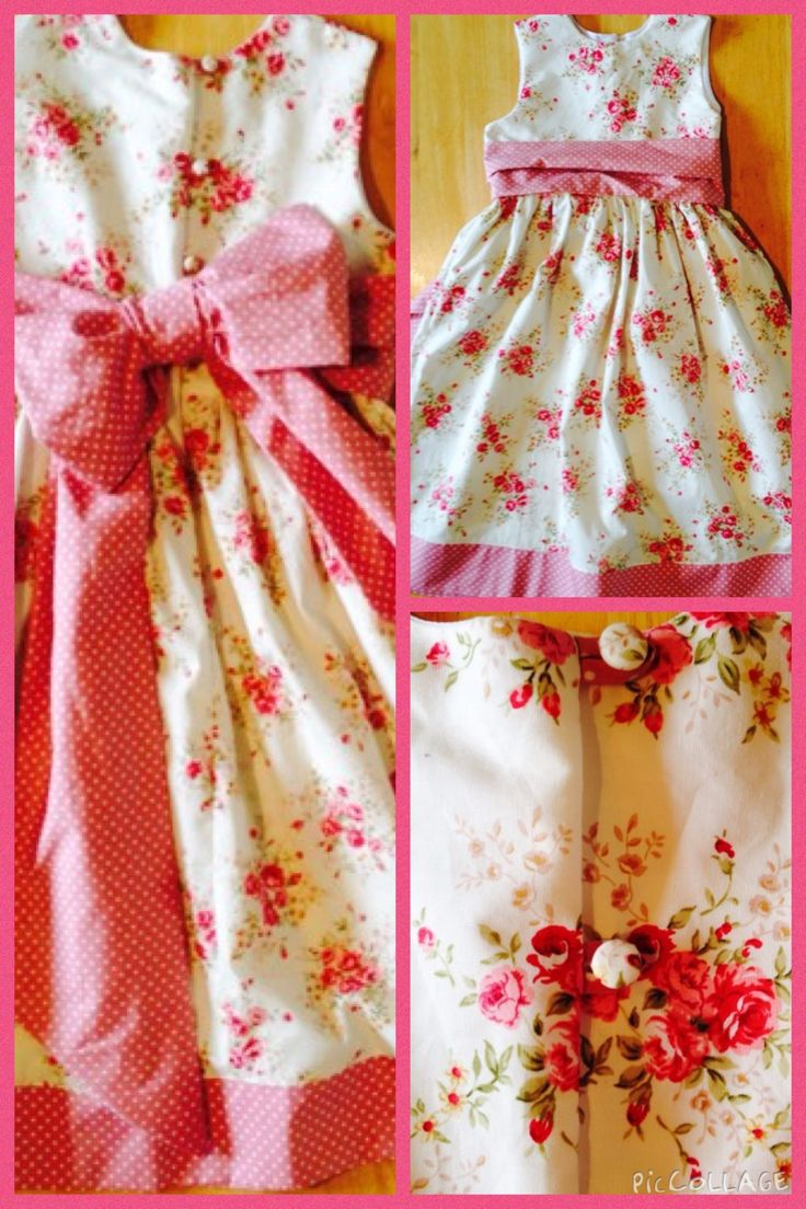 Girls party dress in vintage floral with hand covered buttons, pink polka hem and sash.