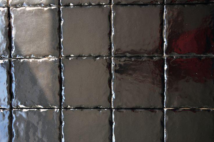 Black handmade tiles. Handmade in Finland. Käsintehdyt laatat.