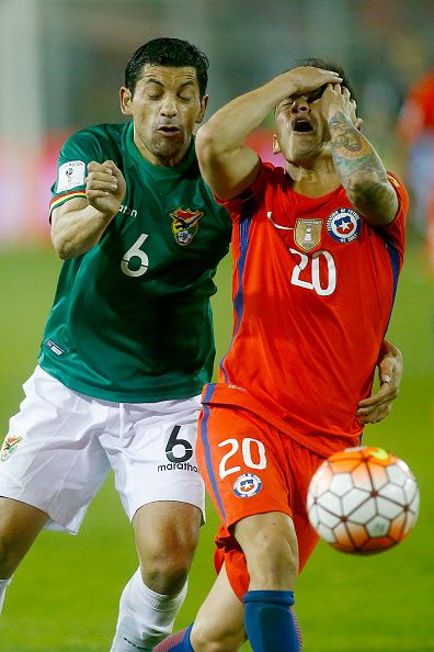 #WCQ2018 Charles Aranguiz of Chile fights for the ball with Walter Flores of Bolivia during a match between Chile and Bolivia as part of FIFA 2018 World Cup...