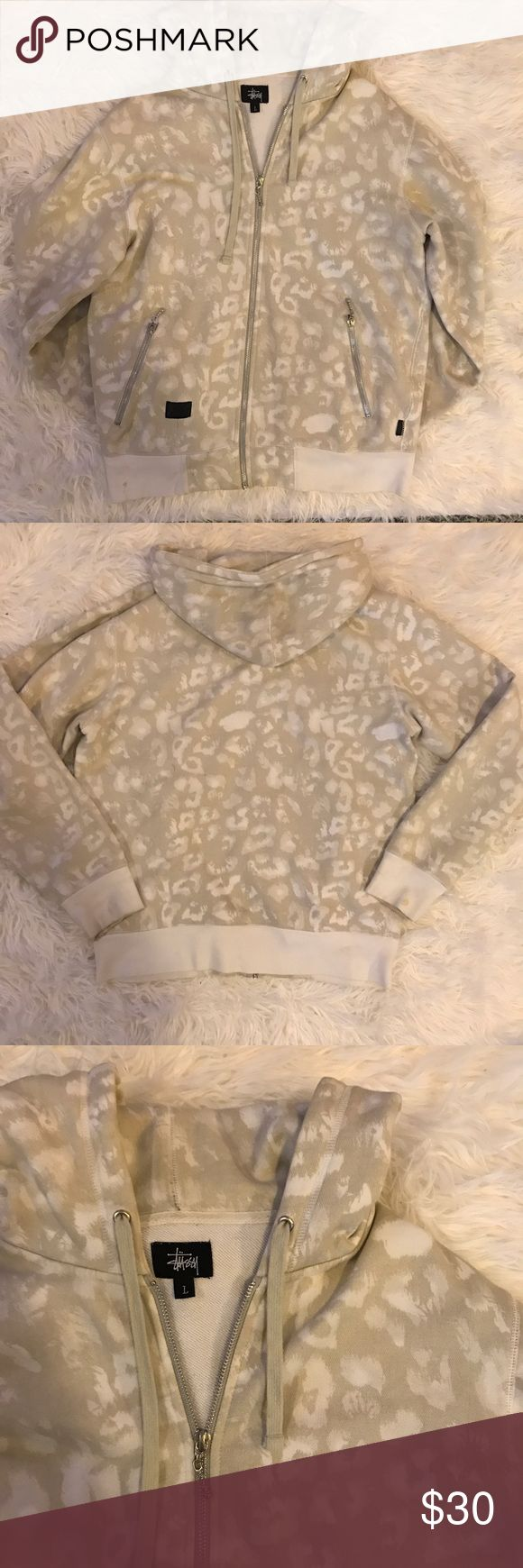 Stussy cheetah print zip up. Size large Stussy cream colored  cheetah print zip up. In used condition, wth a few little stain like down in pictures. Women's size large Stussy Tops Sweatshirts & Hoodies