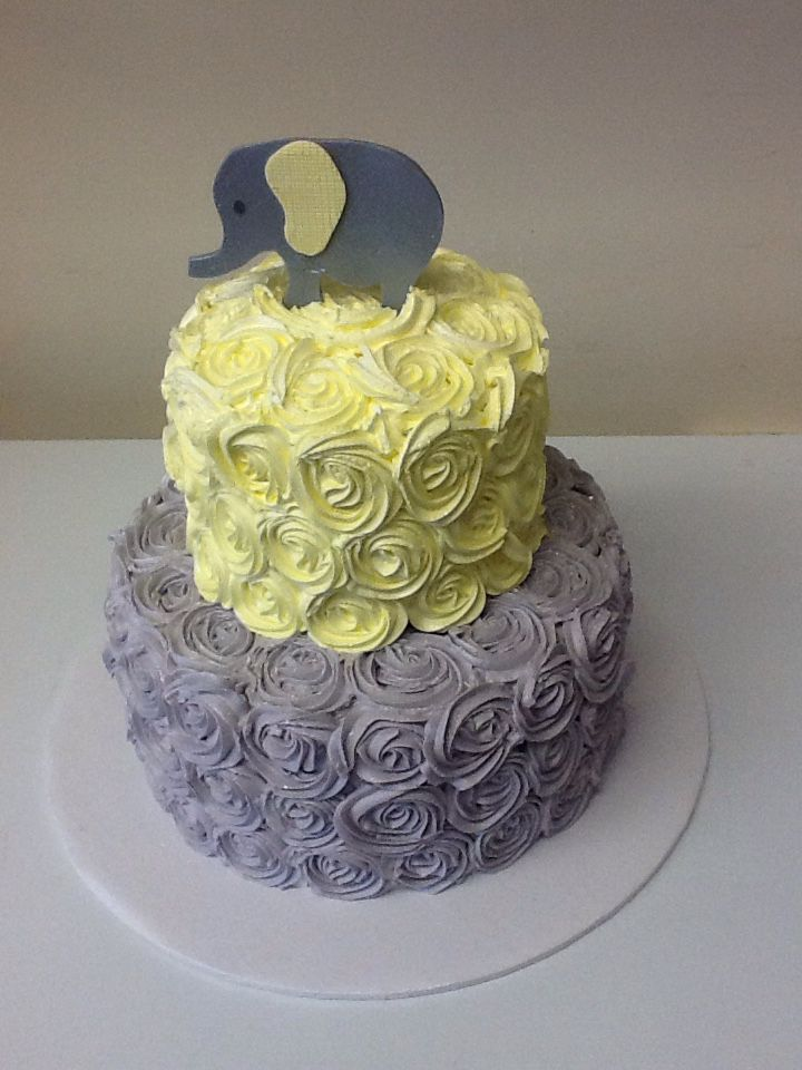 Two tier yellow and grey rosettes baby shower cake