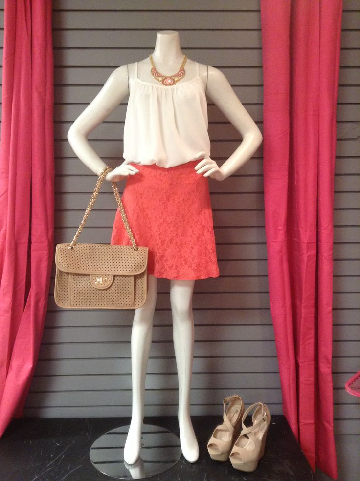 This neutral outfit goes from basic to fun with a coral skirt.