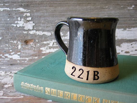 Sherlock Holmes 221 B Baker Street mug.  Each mug is made on the potters wheel in our Strasburg Virginia studio from a warm brown clay, then