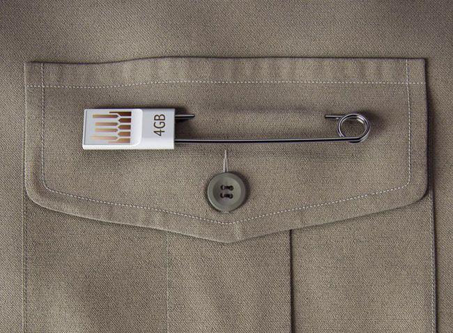 i really like this idea; safety pin USB storage