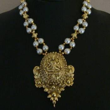 Laxmi necklace-163(temple jewellery), jewellery designs hyderabad, kundan wedding jewellery, terracotta jewellery earrings, south indian earrings jewellery, bridal jewellery sets designs, temple jewellery, maang tikka. I found this beautiful design on Mirraw.com