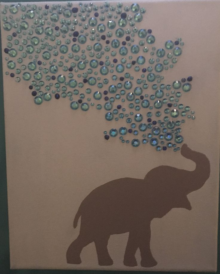 I got this idea from other pins I've seen. I made this for my sister. I painted the canvas light blue and used my cricut to help make an elephant stencil. I pieced together two different elephant silhouettes to create one I liked which I hand painted onto the canvas. The gems, glitter glue, paint, and canvas were all purchased at Walmart.