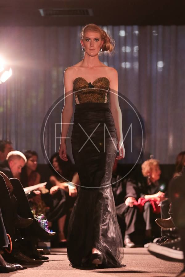 Madame Peacock Corset and Clair De Lune Tulle Evening Skirt- Gorgeous soft peacock feathers on a fully lined deluxe stretch satin corset with our bra shape cups that creates an enviable décolletage. Complimented with lush velvet bow detail, with back hidden zip closure. The busiter accompanying with a luxuriously elegant black tulle evening skirt which features layers of delicate tulle with a fluted bottom and sweeping train reminiscent of old Hollywood glamour.