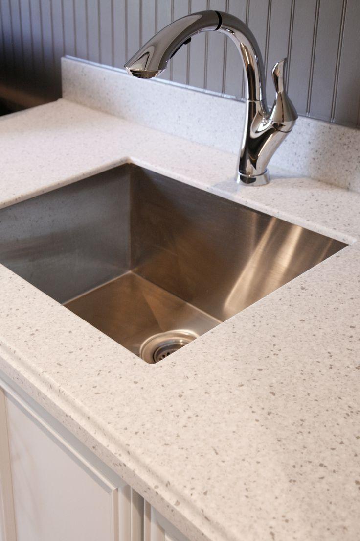 silver birch corian laundry countertop by atlanta kitchen: corian kitchen top