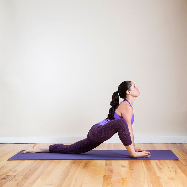 This variation of Lizard pose will open a different part of your hip, as well as offer a nice stretch for the hip flexor, which can also contribute to sciatica discomfort.  From Downward Facing Dog, step your right foot forward between your palms. Keep your hands on the mat, and lower your left knee to the floor, pointing the toes. Slowly lower your right knee to the right, so you're resting on the outside of your right flexed foot. Keep your arms straight, pressing your chest forward just…