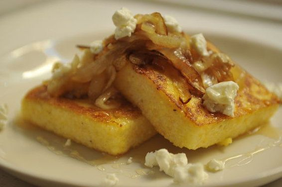 I love, love, love grilled polenta.  Yum!  Griddled Polenta Cakes with Caramelized Onions, Goat Cheese, and Honey