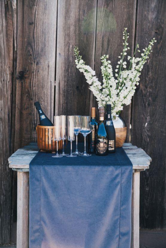 La Tavola Fine Linen Rental: Velvet Charcoal Table Runner | Photography: Alexandra Wallace, Venue: Higuera Ranch, Planning & Styling: A Lovely Creative, Florals: April Flowers, Paper Goods: Salt & Stag