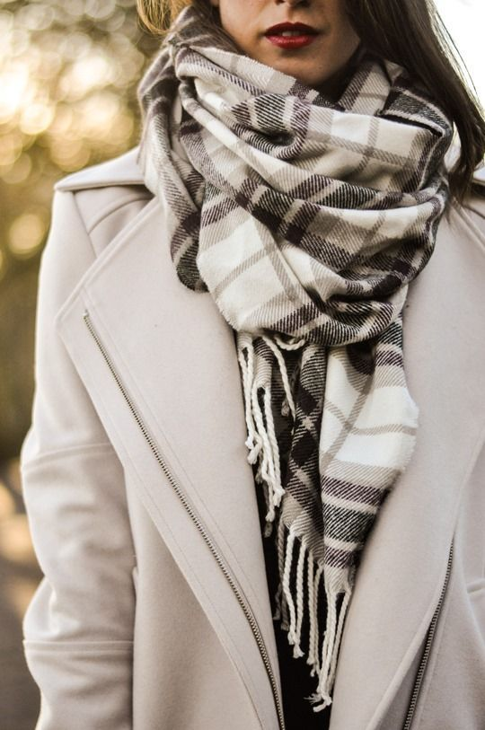 We love how classic this looks. You can't go wrong with a neutral coat and plaid wrap scarf.