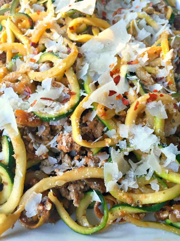 This Ground Turkey Pesto Yellow Squash and Zucchini Noodles is made with a Padnero Spiralizer, delicious served wtih Parmesan cheese.