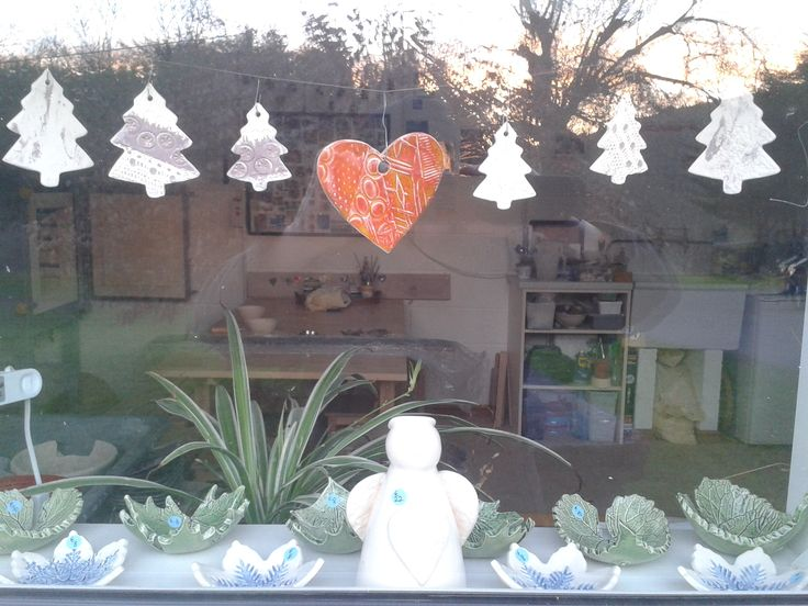 the window of the pottery workshop is looking christmassy