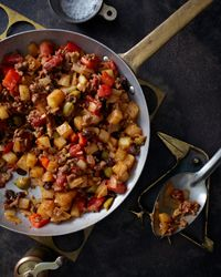 Picadillo Recipe on Food & Wine. Our version of this Cuban classic mixes ground beef with a highly seasoned tomato sauce, fried potatoes, raisins, and green olives. Picadillo, which should be only slightly saucy, often fills empanadas or soft tacos. We like it with corn bread.