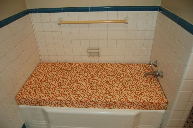 convert unused bathtub into storage and seating area what