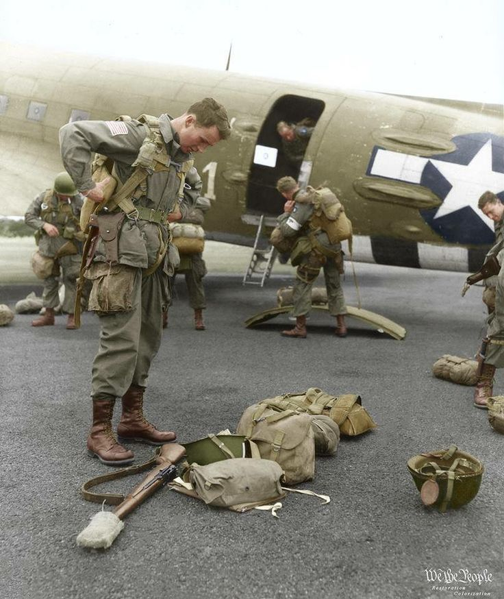 Brigadier General James Gavin, commander of the 82nd All American Airborne Division, checks his equipment before boarding the C-47 which will take him to Holland, thus opening the operation Market-Garden. September 17, 1944.