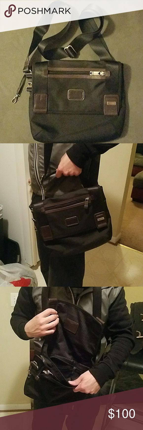 Tumi Small Laptop Tablet Black Shoulder Bag Authentic Tumi Bag Black with Brown leather Adjustable over shoulder laptop / Organizer Bag Magnetic closure along with zipper closure Size 12 inch x 10 inch Strap measures 1ft 5 inches adjustable length. Tumi Bags