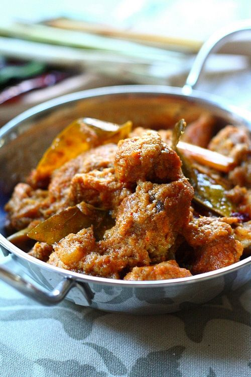 Lamb Rendang (Spicy Lamb Curry) recipe - Rendang is a mildly spicy, rich and flavorful, semi-dry curry that is popular throughout the South-East Asian region and is one of the main dishes that is served during Malay weddings and festivities. #malaysian #lamb