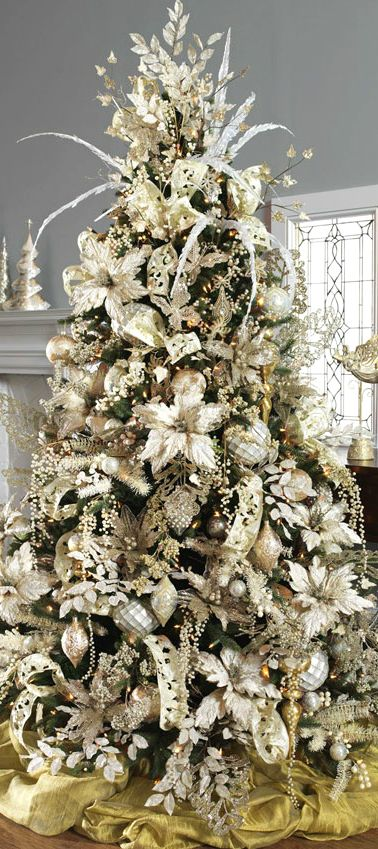 A great frosted gold Christmas tree - wonderfully classic and elegant. As the focal point for your wedding ...maybe even behind you and Brandon as the reference point...@Ashley Walters Walters Walters Walters Walters