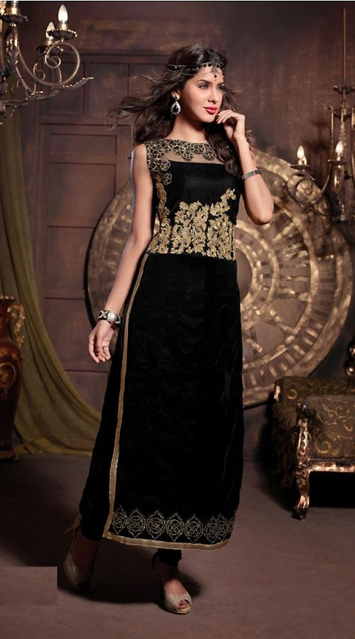 Snazzy black pure velvet designer salwar kameez which is decked with floral work on the neck line, stone, zari embroidery work on the yoke and lower part, golden lace work on the both side and border part. This outfit comes with matching bottom and dupatta. This unstitched suit can be stitched in the maximum bust size of 42 inches.