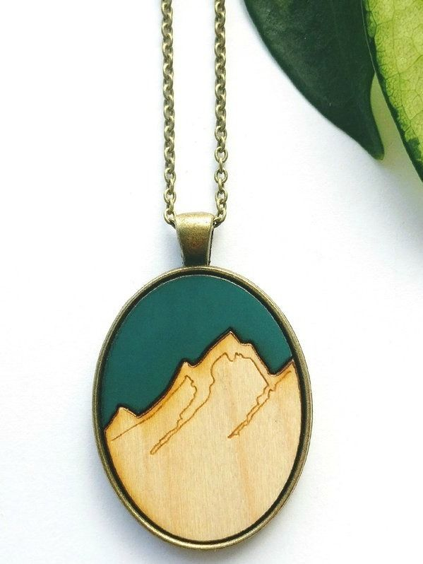 Fresh Tracks Necklace - Forest Green/Maple Wood | An original laser wood cut creations, hand-painted and wrapped in brass. One size fits all!  #madeincanada #canadiandesigner #canadianbrands #canadianclothing #torontobeaches #kensingtonmarket #torontostyle #torontofashion #CanadianDesigners #torontofashionblogger #torontofashionista #madeinbc #canadianfashion #canadianfashionblogger #canadianmade #canadiancreatives #fashioncanada #jewellery #woodnecklace #woodpendant