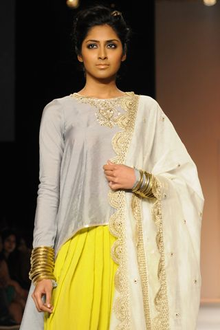 Dusk Grey cotton silk high-low kurta with zardosi embroidery worn with lime Patiala salwar and cream silk mul embroidered dupatta. SHOP THE LOOK: http://www.payalsinghal.com/off-the-runway/chaand-patiala-suit