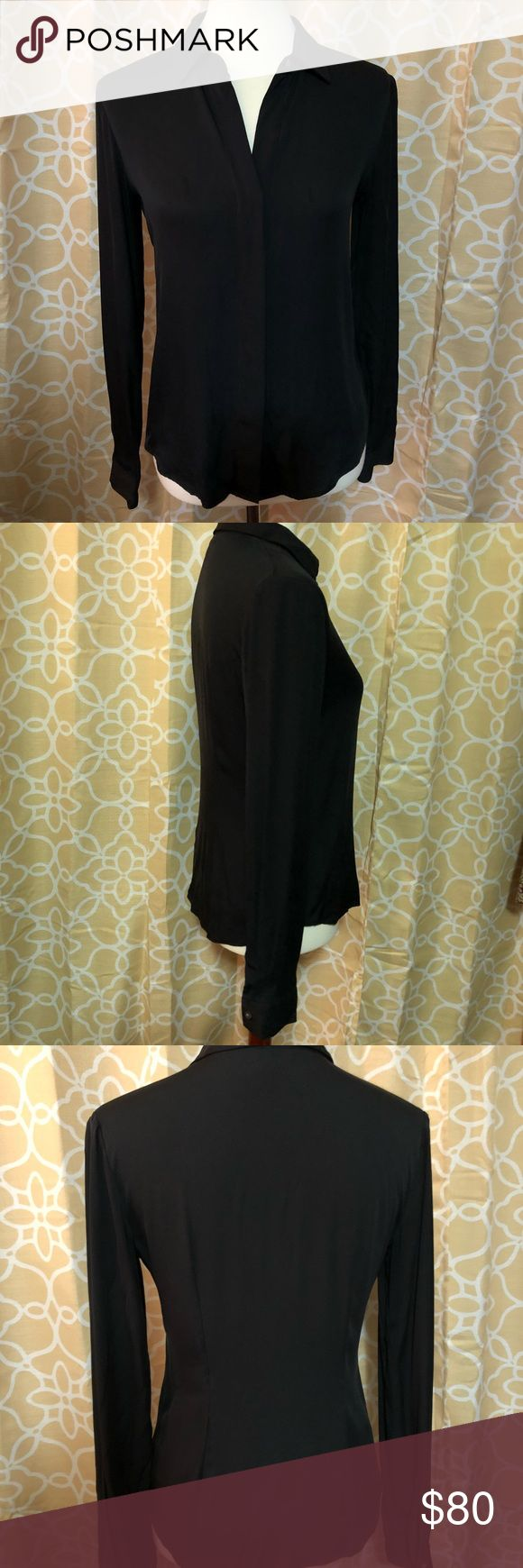 "Theory Black Silk Blend Shirt Luxe on fleek!   Theory long sleeve black silk shirt OMG.  It's gorgeous ladies & will make you feel gorgeous when you wear it styled with a pencil skirt and heels, you'll demand the floor without saying a word.  EUC Size P/TP (Mannequin measures 34""/26""/35"") Theory Tops Button Down Shirts"