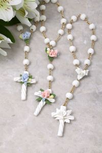 A beautiful keepsake for the precious new baby! Mini Rosary with White Beads Select From Blue, Pink or White Flowers Made in the U.S.A. Comes with Gift Box