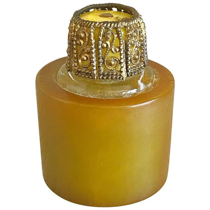Rare 1930s Bakelite Butterscotch Art Deco Travel Size Perfume Bottle and Dauber | From a collection of rare vintage other at https://www.1stdibs.com/fashion/ephemera/other/