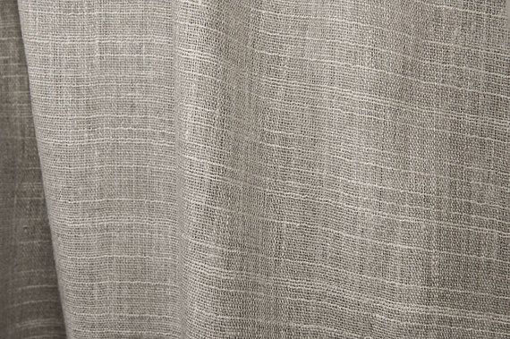"""This linen fabric is woven from natural (grey, undyed) yarns. It was combined with fancy yarns, to create an interesting striped pattern. This striped medium-weight fabric is made from 100% linen. It is perfect for handicrafts - bed linen, clothing, curtains, garments accessories, kitchen linen, table linen.  Width – 150 cm (59"""") Weight - 150g / m² (4.42oz / yd²) Pattern - plain weave Article Nr.- 5113501L  All prices are given in half (0.5m) meters. If you are interested to purchas..."""