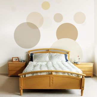Full Circle : Add polka dots or other shapes to the wall behind your bed for instant artwork. Stenciling the circles is one option, but you can also buy stick-on wall art at most arts and crafts stores    Read more: Bedroom Decorating Ideas - Decorating a Master Bedroom - Good Housekeeping